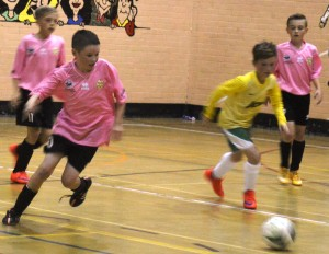 Local futsal coaching sessions at YMCA for junior players; team opportunities.