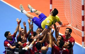 Iran's team players throw in the air Brazilian player Falcao as they celebrate their victory over Brazil in their Colombia 2016 FIFA Futsal World Cup match in Bucaramanga, Colombia on September 21, 2016. / AFP PHOTO / GUILLERMO LEGARIAGUILLERMO LEGARIA/AFP/Getty Images