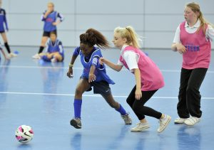 BURTON UPON TRENT, ENGLAND. - JULY 3:  School children play futsal during the Team Sixteen Reward and Recognition Day at St Georges Park on July 3, 2014 in Burton Upon Trent, England (Photo by Clint Hughes - The FA via Getty Images)